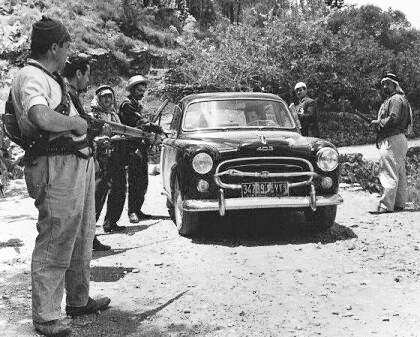 Kamal Joumblat Druze rebels search a car at gunpoint in the Chouf region (1958)